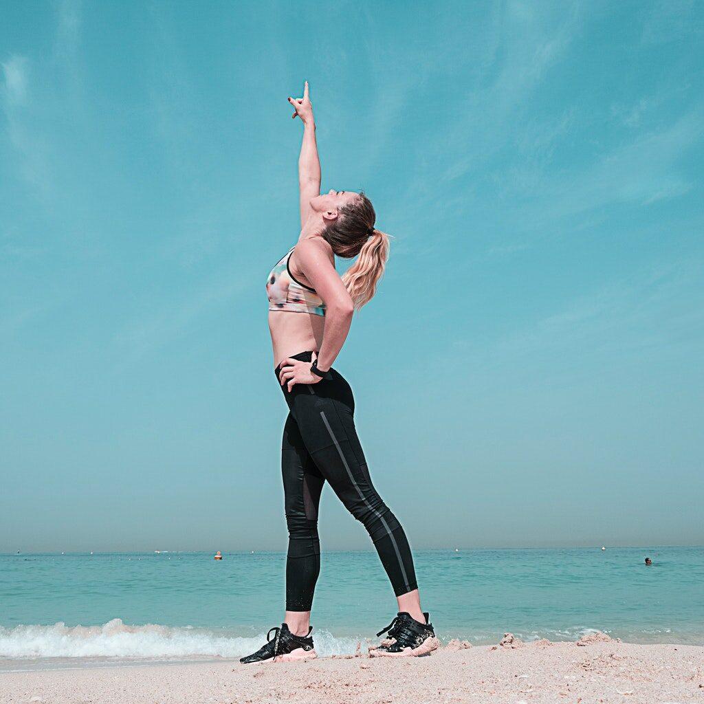 woman-pointing-at-sky-on-seashore-1117493.jpg
